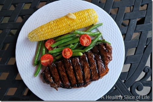 summer steak dinner with green beans and corn